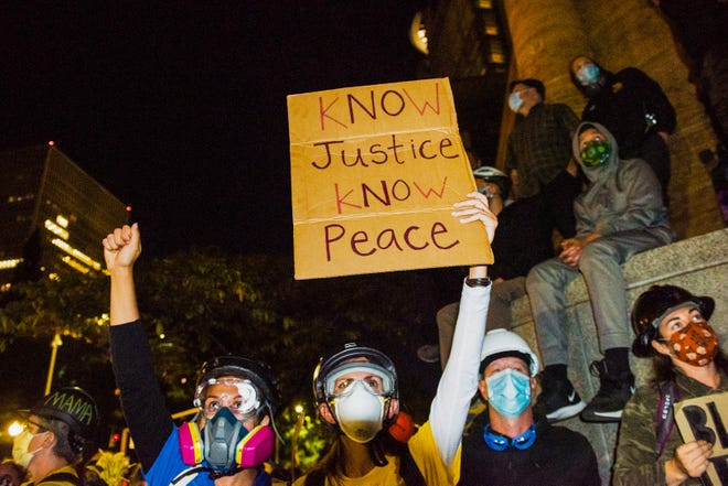 Protests against racial injustice continue with Seattle police in US
