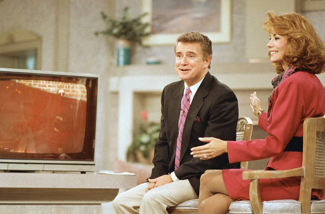 "Regis Philbin and Kathie Lee Gifford react during a WABC-TV broadcast of ""Live! With Regis and Kathie Lee"" on Sept. 8, 1988, in New York."