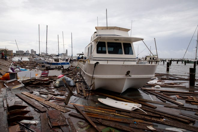 Debris fought among boats in the heavily damaged Harbor Del Sol Marina the morning after Hurricane Hanna on Sunday, July 26, 2020.