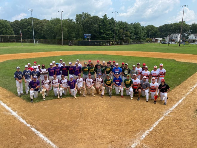 Senior baseball players from Cherry Hill West, Glassboro, Triton, Audubon, Schalick, Lenape, Cherokee, Collingswood, Delsea, Rancocas Valley and Absegami pose for a picture during the One More Game event at Walt Nicgorski Sports Complex in Pennsauken on July 26.
