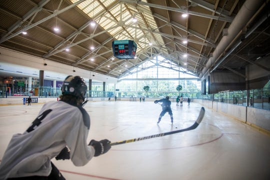 Hockey players skate around the ice rink during the reopening of the Coral Ridge Mall Ice Arena on Sunday, July 26, 2020 in Coralville, Iowa. Renovations included replacing the ice, repainting all of the logos, and installing a new cooling tower. (Katina Zentz/Iowa City Press-Citizen)