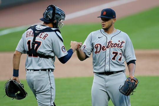 Tigers catcher Grayson Greiner and pitcher Joe Jimenez celebrate after the Tigers' 6-4 win over the Reds on Saturday, July 25, 2020, in Cincinnati.