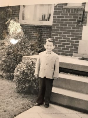 Richard DeVore in 1960 in front of family's home in Dearborn.