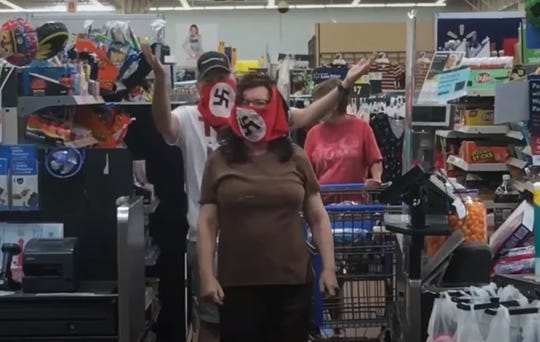 A couple was captured on video wearing swastika masks inside a Walmart on Saturday.