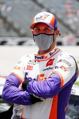 Denny Hamlin stands next to his car on pit road prior to a NASCAR Cup Series auto race July 19 at Texas Motor Speedway