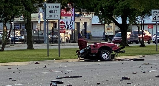 The rear end of a Ford Mustang that landed in the far left lane in front of the Wendy's on 8 mile in Southfield on Saturday, July 25, 2020.