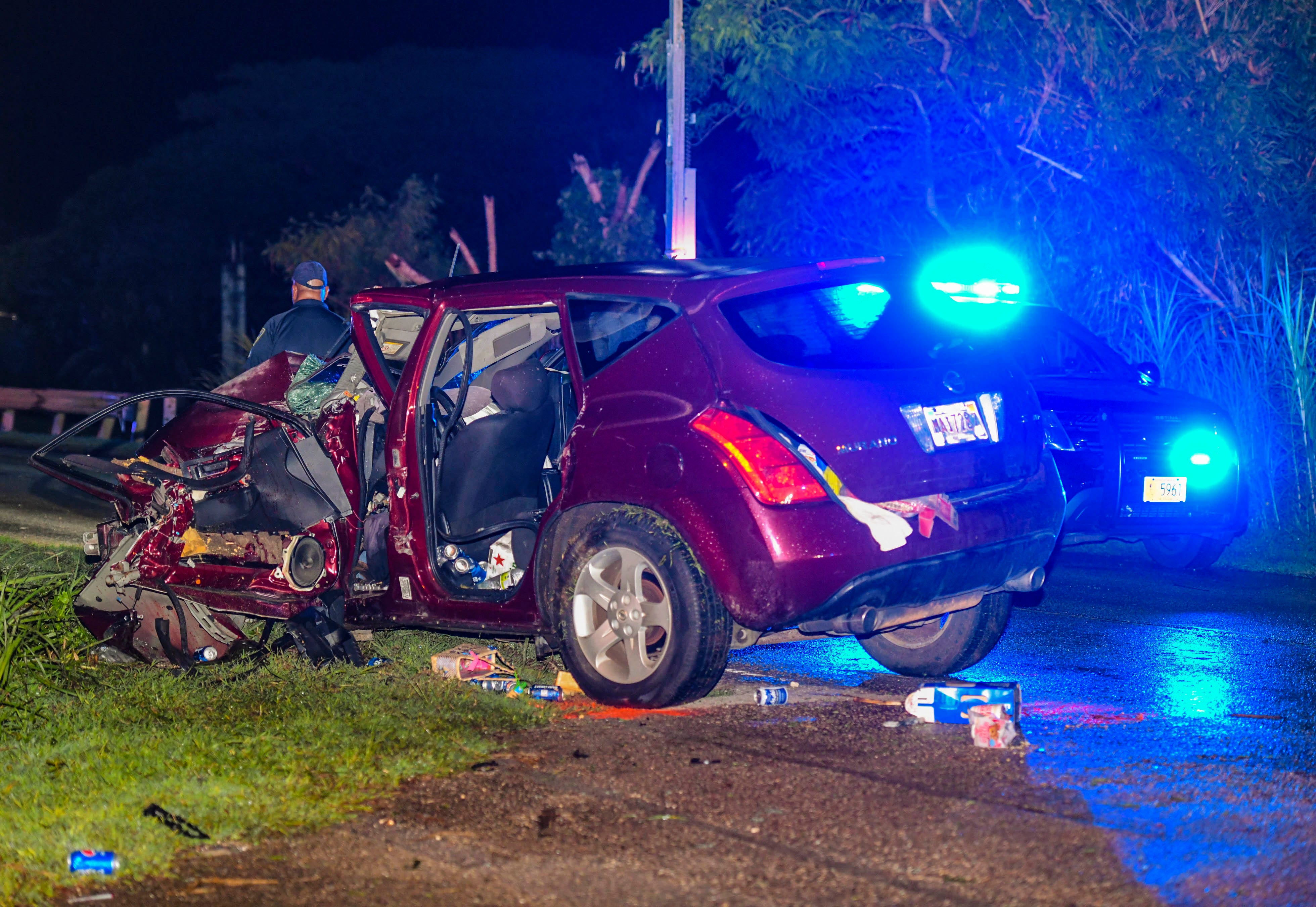 Highway Patrol Division officers with the Guam Police Department conduct an investigation of a fatal crash involving a Nissan Murano colliding into a concrete utility pole along Route 15, near the Hello Market in Yigo, on the evening on Sunday, July 26, 2020. Firefighters with the Guam Fire Department used the Jaws of Life to extricate the male operator and sole occupant of the vehicle, who was pulseless and breathless, at the scene according to GFD spokesman Kevin Reilly. CPR was performed on the driver as he was transported to the Guam Regional Medical City, Reilly added.