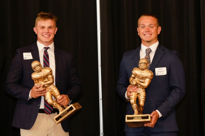 Sam Carson, center, and Ayden Ayres hold their State Scholar-Athlete of the Year trophies during the annual Joe Tiller Chapter of Northwest Indiana National Football Foundation honors dinner, Sunday, July 26, 2020 in Lafayette.