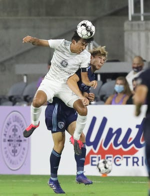 Louisville City FC's Jonathan Gomez (42) fights for the ball with Sporting KC II's Mason Leeth (71) during the second half of play at Lynn Family Stadium in Louisville, Kentucky.     July 25,  2020.