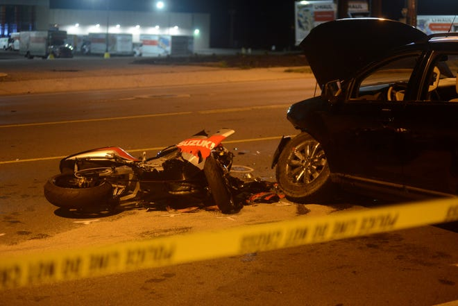 Police closed a portion of Park Avenue West Saturday night to investigate a crash involving a car and a motorcycle.