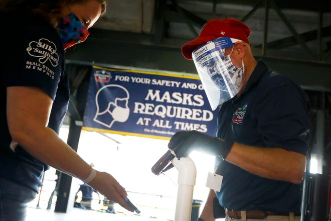 Guest service rep. Gary Sneed scans in tickets as fans enter to see Memphis 901 FC take on the Charlotte Independence on Saturday, July 25, 2020 during the first live action at AutoZone Park since the season was put on hold to prevent the spread of the coronavirus back in March after the team's first game of the season.