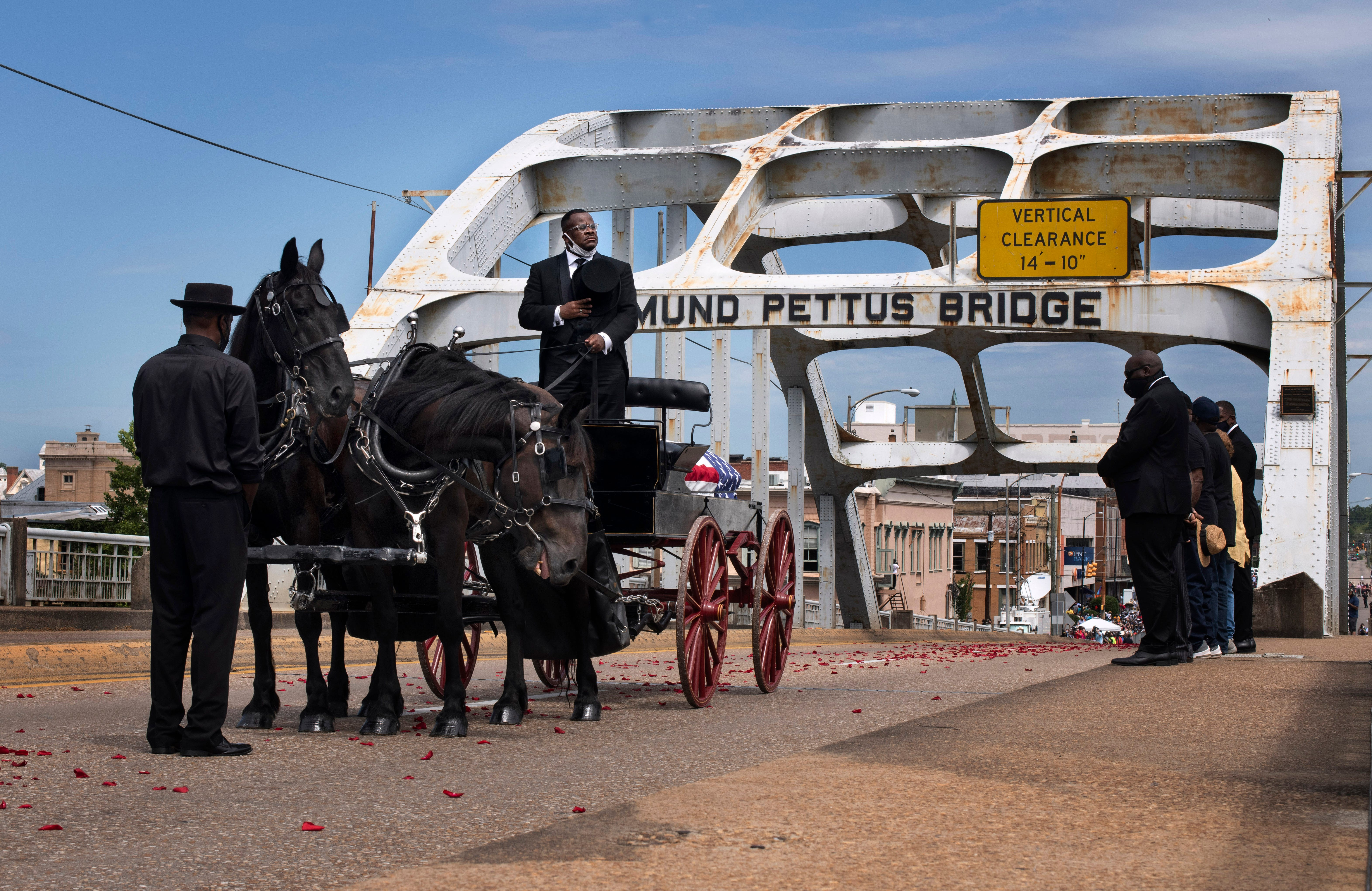 A nation John Lewis helped unite salutes him on his final journey across Selma bridge