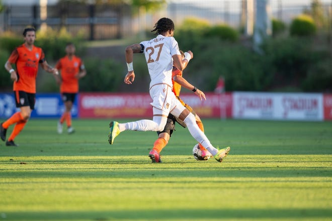 Phoenix Rising FC midfielder Kevon Lambert (27) chases a player in a game against Orange County SC on July 25, 2020, at Orange County Soccer Club.