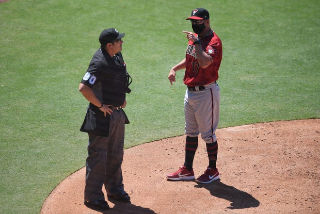 Jul 26, 2020; San Diego, California, USA; Arizona Diamondbacks manager Torey Lovullo (R) speaks with umpire Mark Ripperger (90) after being ejected during the fifth inning against the San Diego Padres at Petco Park. Mandatory Credit: Orlando Ramirez-USA TODAY Sports