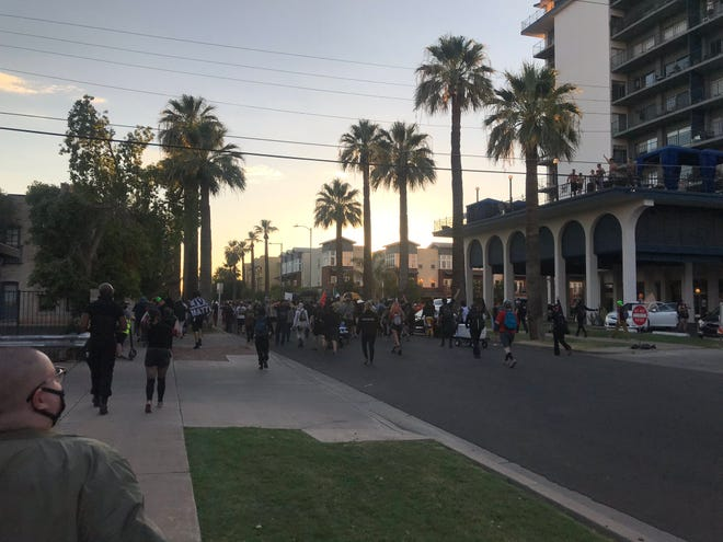Protesters march on McKinley Street on July 26, 2020.