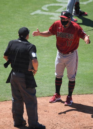 Jul 26, 2020; San Diego, California, USA; Arizona Diamondbacks manager Torey Lovullo (17) has words with umpire Mark Ripperger (90) during the fifth inning against the San Diego Padres at Petco Park. Mandatory Credit: Orlando Ramirez-USA TODAY Sports