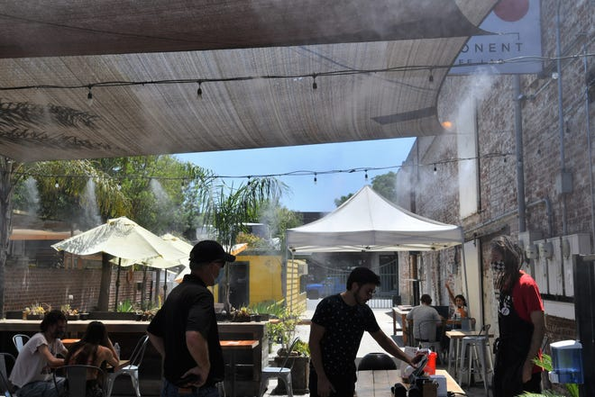 Refreshing misters and shades provide a cool retreat for patrons at Component Coffee Lab in downtown Visalia.