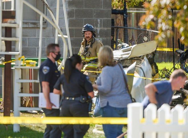 Emergency crews  respond to a small plane crash, Saturday, July 25, 2020, in West Jordan, Utah. (Leah Hogsten/The Salt Lake Tribune via AP)