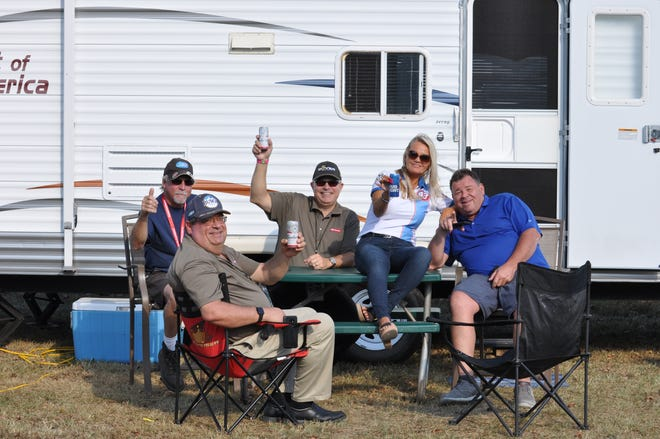 File photo of fans tailgating at Dover International Speedway in October.