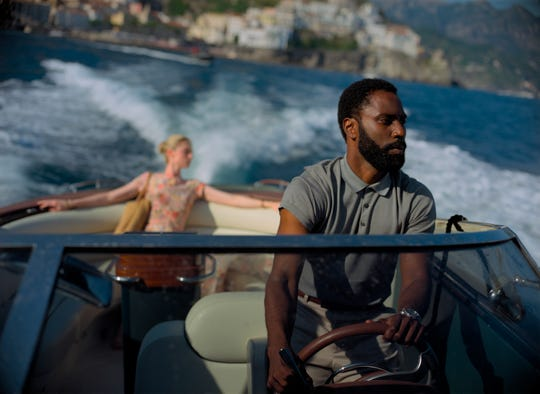 """Elizabeth Debicki and John David Washington in """"Tenet,"""" which is set to open Aug. 26 in 70 countries before opening in select U.S. cities on Sept. 3."""