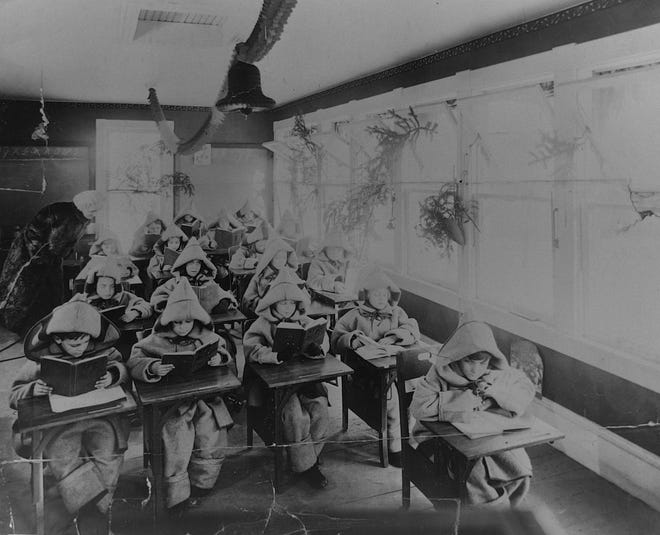 """In this undated photo, students of a """"fresh air school"""" on West Van Buren Street in Battle Creek attend to their studies. Fresh-air schools, known also as open-air schools, opperated in Battle Creek from 1914 until 1933, and were designed to prevent and combat the widespread rise of tuberculosis."""