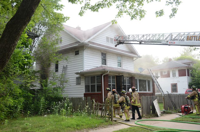 Battle Creek firefighters were called to a house on fire on Greenwood Avenue on Monday morning.  Trace Christenson/The Enquirer