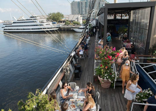 Patrons dine on the deck of the tall ship Moshulu located at Penn's Landing in Philadelphia, Friday, July 17, 2020. Below deck dining is unavailable due to governement COVID-19 restrictions.
