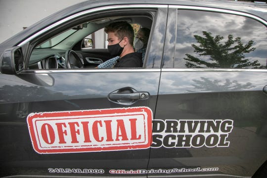 Asher Meltzer, 15, of Bloomfield Hills finishes his day of driver training with Benny Malburg, 33, President and Owner of Official Driving School at their headquarters in Royal Oak Thursday, July 23, 2020.