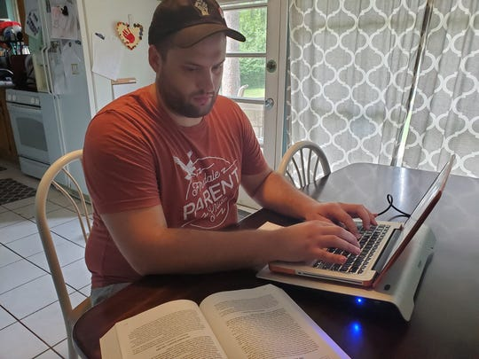 Casey Cheney studies for the upcoming Michigan bar exam. The Wayne State University Law School graduate has concerns about the exam being shifted to online this year.