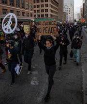 Black Lives Matter protesters march through downtown Oakland on Saturday. Protesters in California set fire to a courthouse, damaged a police station and assaulted officers after a peaceful demonstration intensified late Saturday, Oakland police said.