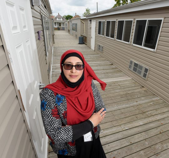 Hamtramck Public Schools Superintendent Jaleelah Ahmed poses among 10 mobile classrooms at Dickinson  West Elementary School.