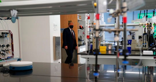 President Donald Trump participates in a tour of Bioprocess Innovation Center at Fujifilm Diosynth Biotechnologies, Monday, July 27, 2020, in Morrisville, N.C.