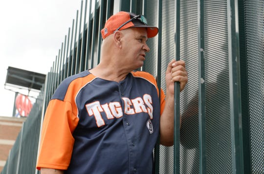 David Willis, 60, of Detroit, watches the pregame players warm-up from the centerfield fence of Comerica Park as Tigers fans prepare for opening day at Comerica Park in downtown Detroit, Monday, July 27, 2020. Willis said he has been doing this for the last 10 years from the same spot.