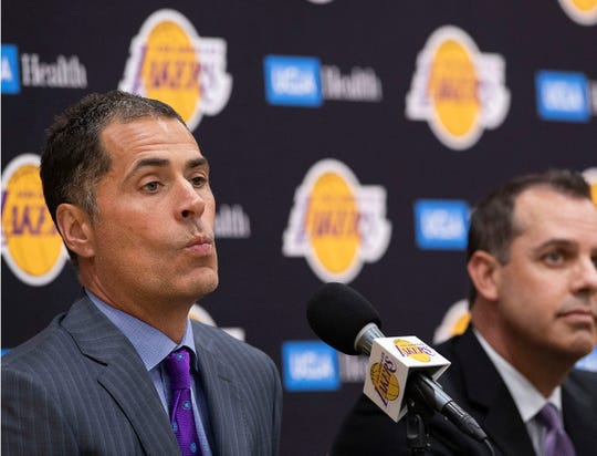 Lakers GM Rob Pelinka, left, and head coach Frank Vogel had to serve as practice cones in the bubble.