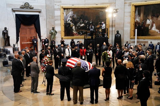 Members of the Congressional Black Caucus, say farewell at the conclusion of a service for the late Rep. John Lewis, D-Ga., a key figure in the civil rights movement and a 17-term congressman from Georgia, as he lies in state at the Capitol in Washington, Monday, July 27, 2020.