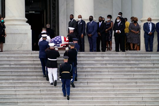 The flag-draped casket of the late Rep. John Lewis, D-Ga., carried by a joint services military honor guard, arrives to lie in state in the Capitol Rotunda, Monday, July 27, 2020, in Washington.