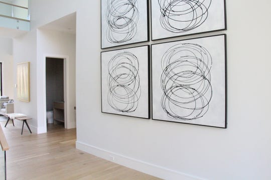 Artwork placed vertically helps create the look of a single, large art piece.