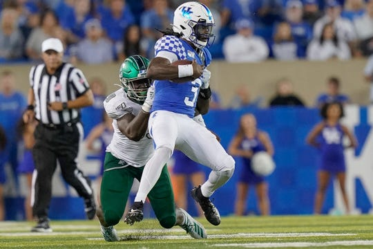 Kentucky quarterback Terry Wilson is tackled by Eastern Michigan defensive lineman Turan Rush in the 2019 game. Wilson injured his knee and was lost for the season.