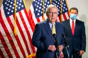 Senate Majority Leader Mitch McConnell, R-Ky., with Sen. John Barrasso, R-Wyo., speaks to reporters on Capitol Hill, in a Tuesday, June 30, 2020 file photo, in Washington.