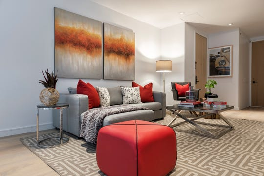 Two pieces of bright artwork in a series perks up a family room.