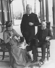 First Lady Lucy Hayes and President Rutherford B. Hayes, center, sit with friend William Henry Smith, right, on the verandah of the Hayes Home. Smith was the editor of the Western Associated Press.
