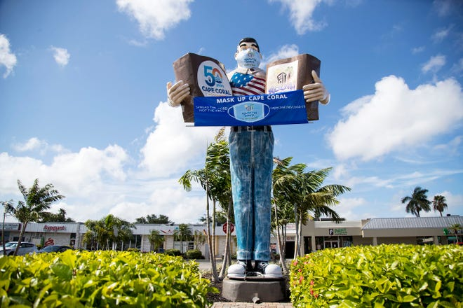 Cape Coral's Big John statue has been outfitted with a mask and a banner encouraging residents to mask up.