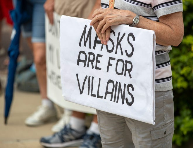 There were handmade signs on display as about 60 protesters cited Indiana and federal constitutions as reasons for their dismissal of government mask mandates during the coronavirus pandemic, rallied at the Indiana Statehouse, Indianapolis, Monday, July 27, 2020.