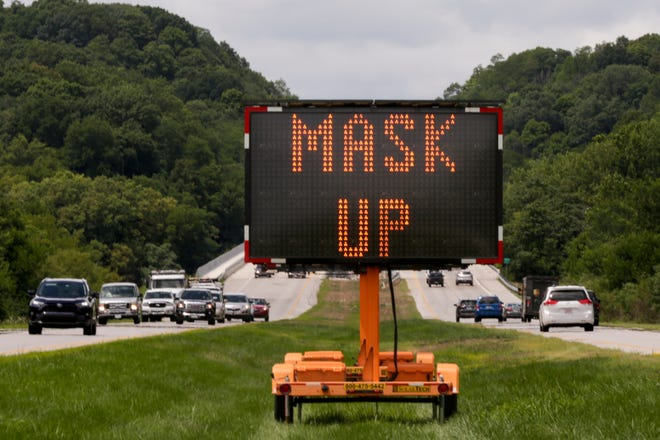 """""""Please Mask Up"""" scrolls across an electronic sign on Sagamore Parkway before the Wabash River bridge, Monday, July 27, 2020 in Lafayette. Tippecanoe County offices and Lafayette city buildings transition Tuesday, April 20, 2021, to a mask advisory. This means that masks are not mandatory."""