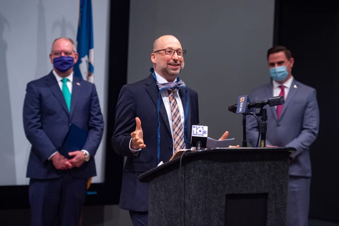 Bryan MacDonald, Chief Executive Officer of SchoolMint, announcing relocation of the education software company to Lafayette, with Gov. John Bel Edwards to the left and Lafayette Mayor-President Josh Guillory on right. Monday, July 27, 2020.