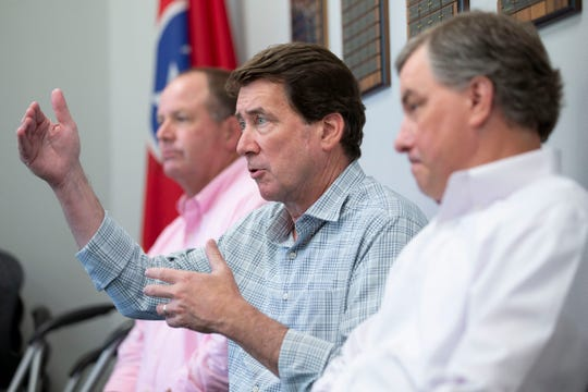 U.S. Senate candidate Bill Hagerty (center) speaks to a group while seated between State Rep. Kevin Vaughan (left) and State Rep. Ron Gant on Monday, July 27, 2020, at the West Tennessee Home Builders Association in Collierville.
