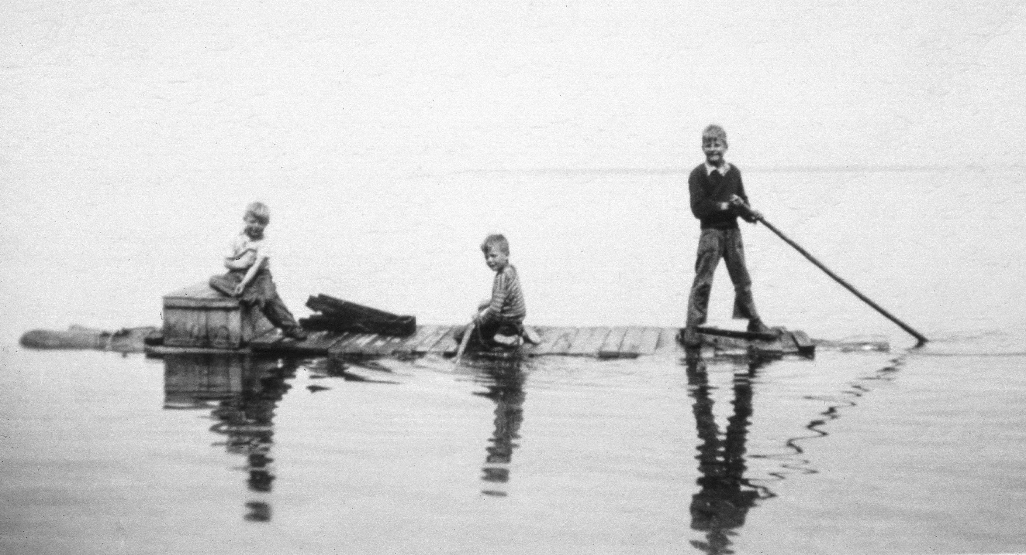 Bob Dahl, center at age 6, his brother Carl Dahl  Jr,. right at age 9, and cousin Paul Hansen, left, explore Lake Superior at Sand Island in 1948 on a raft fashioned from salvaged materials. The Dahls lived on a property on Sand Island before the Apostle Islands became a national lakeshore in 1970.