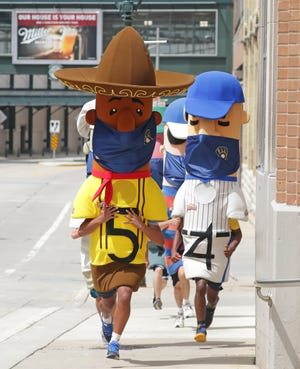 The Milwaukee Brewers' Johnsonville Famous Racing Sausages race through the Molson Coors campus in Milwaukee last year.