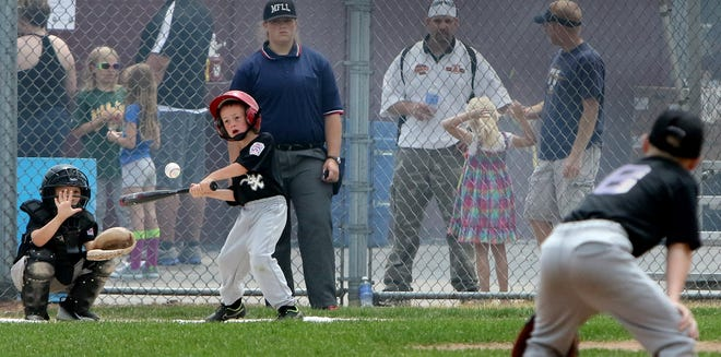 Little League teams from Menomonee Falls play in a game during the organization's 25 anniversary celebration in 2015. After suspending its season July 23 because players and coaches tested positive for the coronavirus, the league is resuming play Aug. 3.