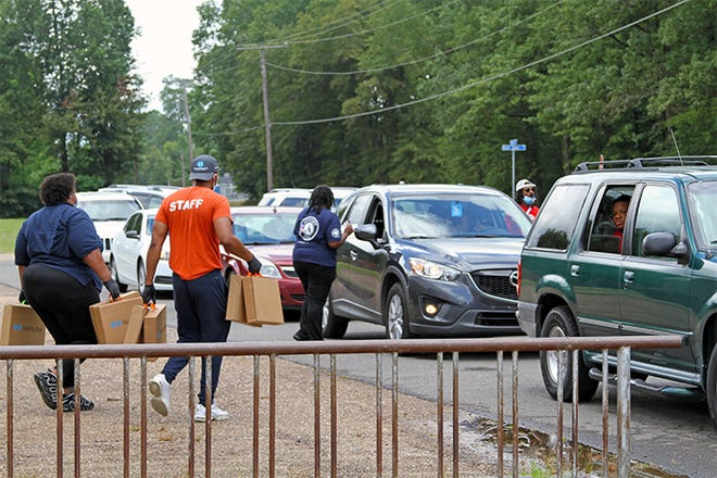 The Boys & Girls Clubs of North Louisiana handed out 397 boxes full of school supplies on Friday at its West Monroe Club location off Evergreen Street.